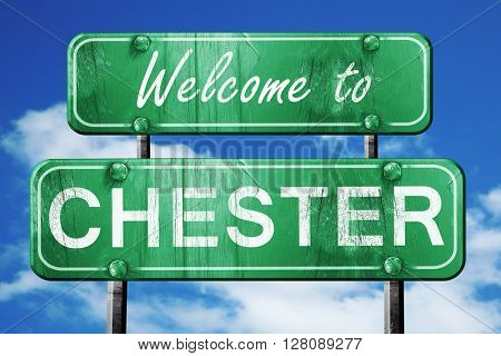 chester vintage green road sign with blue sky background