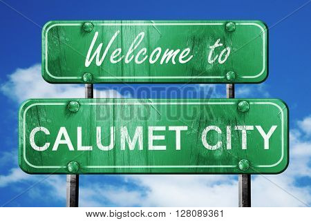 calumet city vintage green road sign with blue sky background