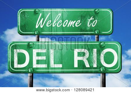 del rio vintage green road sign with blue sky background
