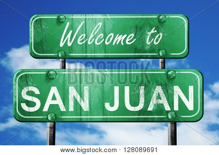 san juan vintage green road sign with blue sky background