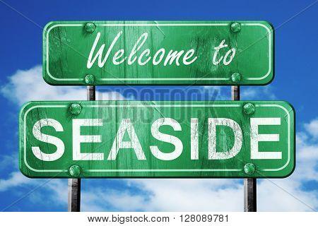 seaside vintage green road sign with blue sky background