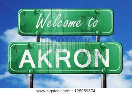 akron vintage green road sign with blue sky background
