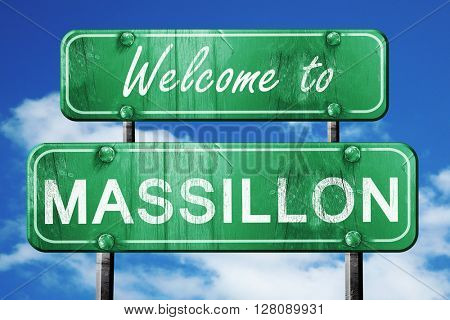massillon vintage green road sign with blue sky background