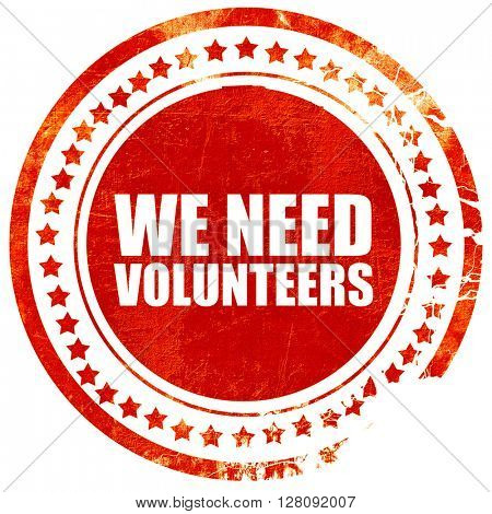 we need volunteers, grunge red rubber stamp with rough lines and