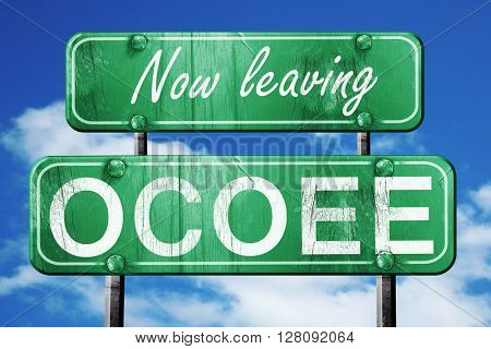 Leaving ocoee, green vintage road sign with rough lettering