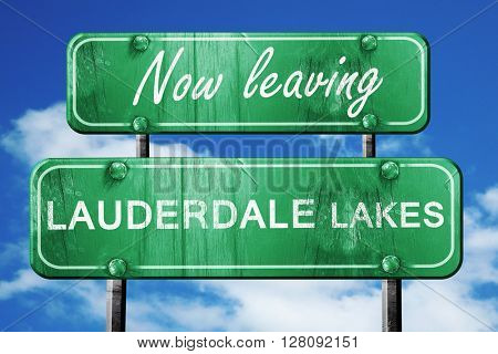 Leaving lauderdale lakes, green vintage road sign with rough let