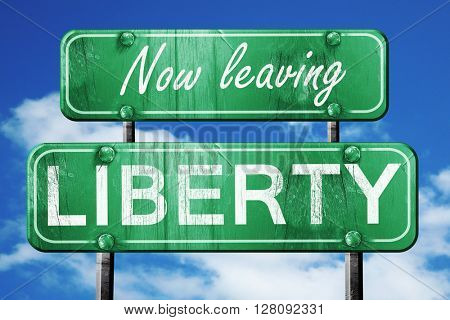 Leaving liberty, green vintage road sign with rough lettering