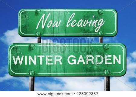 Leaving winter garden, green vintage road sign with rough letter