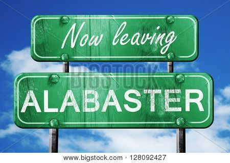 Leaving alabaster, green vintage road sign with rough lettering