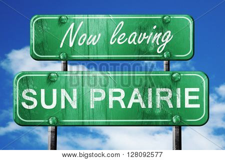 Leaving sun prairie, green vintage road sign with rough letterin