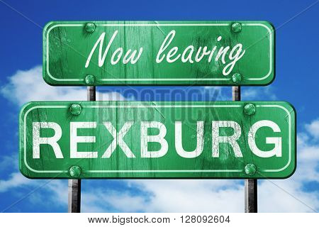 Leaving rexburg, green vintage road sign with rough lettering