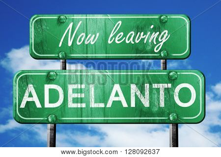 Leaving adelanto, green vintage road sign with rough lettering