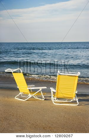 Empty lounge chairs on beach on Bald Head Island, North Carolina.