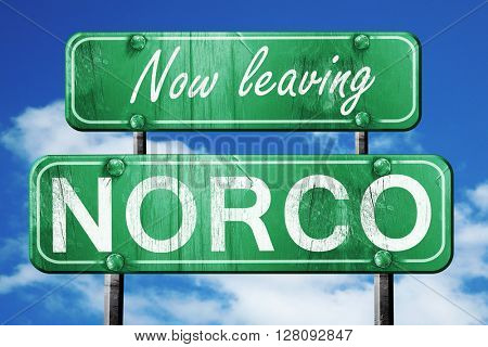 Leaving norco, green vintage road sign with rough lettering