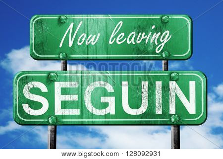 Leaving seguin, green vintage road sign with rough lettering
