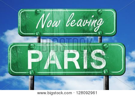 Leaving paris, green vintage road sign with rough lettering