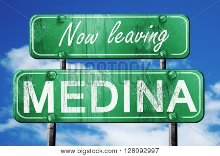 Leaving medina, green vintage road sign with rough lettering