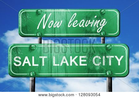 Leaving salt lake city, green vintage road sign with rough lette