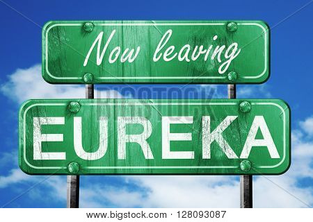 Leaving eureka, green vintage road sign with rough lettering