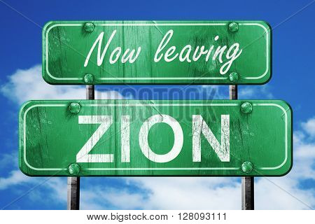 Leaving zion, green vintage road sign with rough lettering