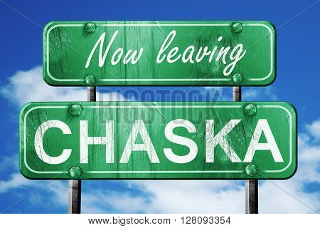 Leaving chaska, green vintage road sign with rough lettering
