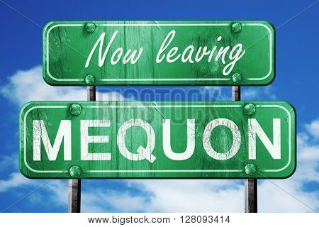 Leaving mequon, green vintage road sign with rough lettering