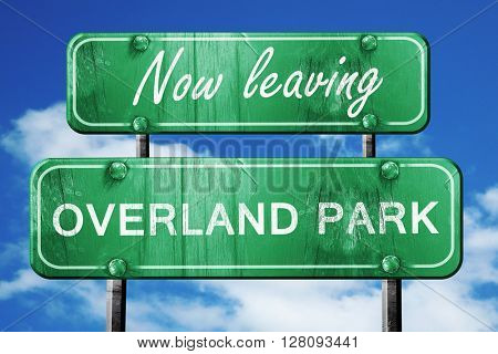 Leaving overland park, green vintage road sign with rough letter