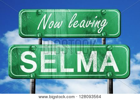 Leaving selma, green vintage road sign with rough lettering