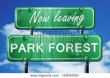 Leaving park forest, green vintage road sign with rough letterin