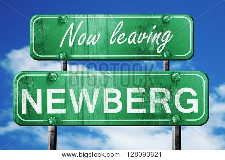 Leaving newberg, green vintage road sign with rough lettering