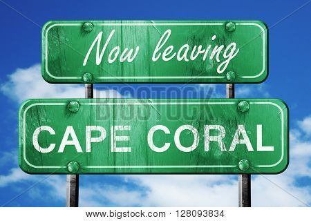 Leaving cape coral, green vintage road sign with rough lettering