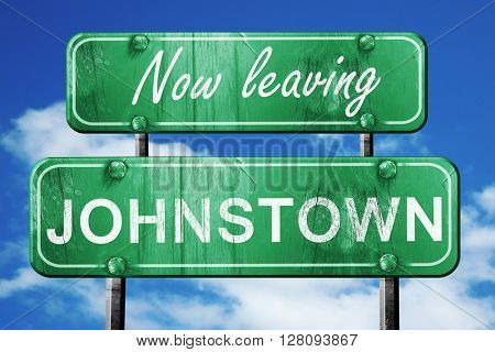 Leaving johnstown, green vintage road sign with rough lettering