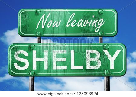 Leaving shelby, green vintage road sign with rough lettering
