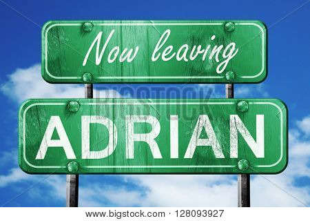 Leaving adrian, green vintage road sign with rough lettering
