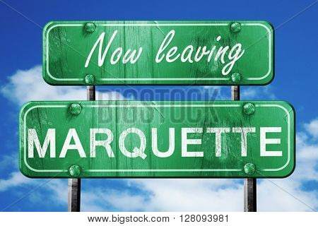 Leaving marquette, green vintage road sign with rough lettering