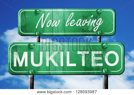 Leaving mukilteo, green vintage road sign with rough lettering