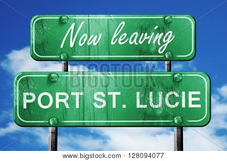 Leaving port st. lucie, green vintage road sign with rough lette