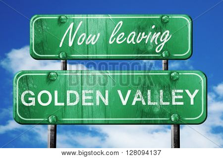 Leaving golden valley, green vintage road sign with rough letter