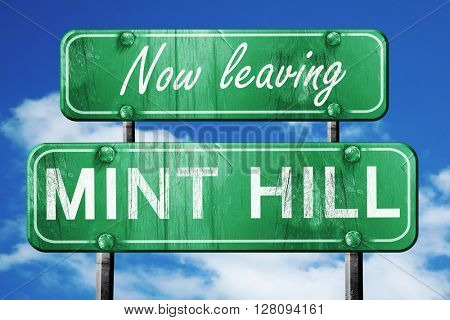 Leaving mint hill, green vintage road sign with rough lettering