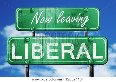 Leaving liberal, green vintage road sign with rough lettering