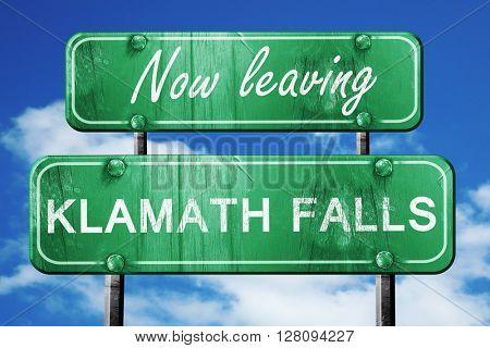 Leaving klamath falls, green vintage road sign with rough letter