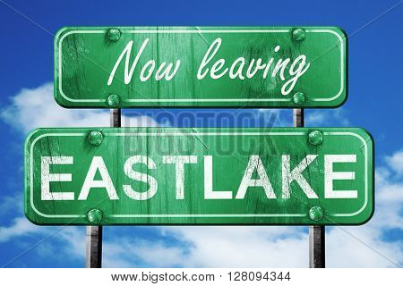 Leaving eastlake, green vintage road sign with rough lettering