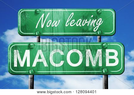 Leaving macomb, green vintage road sign with rough lettering