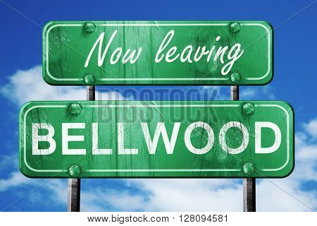 Leaving bellwood, green vintage road sign with rough lettering