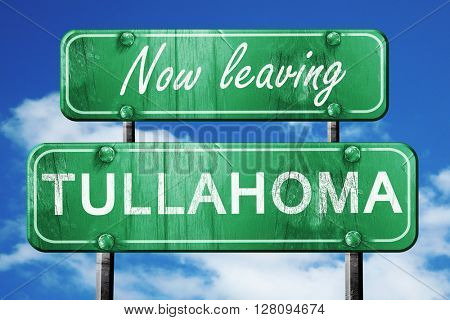 Leaving tullahoma, green vintage road sign with rough lettering