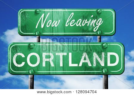 Leaving cortland, green vintage road sign with rough lettering