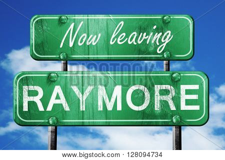 Leaving raymore, green vintage road sign with rough lettering
