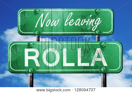 Leaving rolla, green vintage road sign with rough lettering