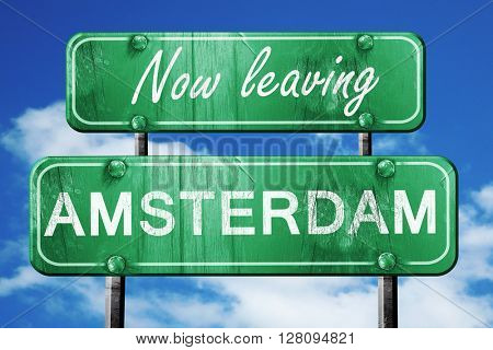 Leaving amsterdam, green vintage road sign with rough lettering