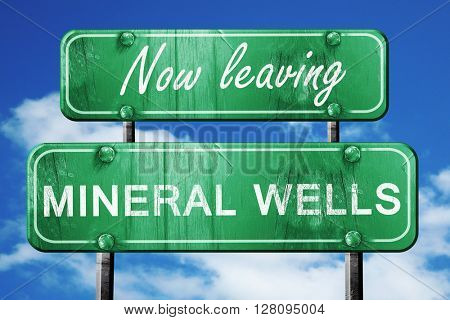 Leaving mineral wells, green vintage road sign with rough letter